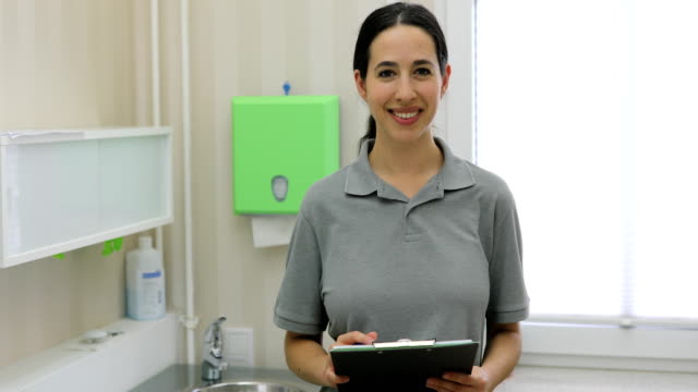 woman working in a hospital - waist up stock videos & royalty-free footage