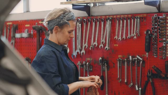 woman working in a repair workshop - wrench stock videos & royalty-free footage