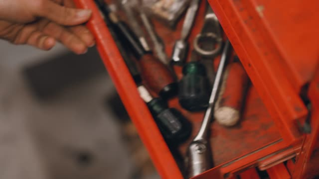 woman working in a repair workshop - drawer stock videos & royalty-free footage