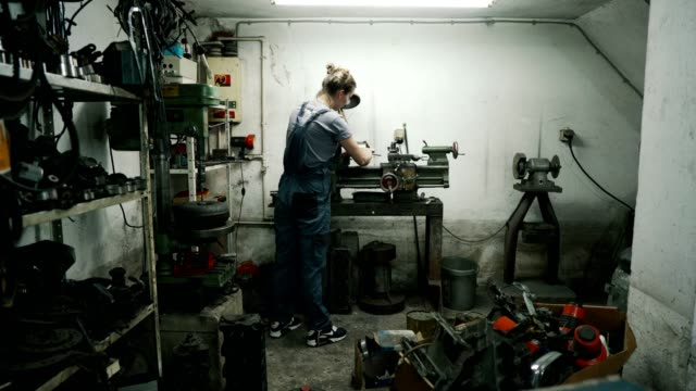 woman working in an auto repair shop - gender stereotypes stock videos & royalty-free footage