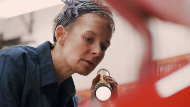 woman working in an auto repair workshop - electric torch stock videos & royalty-free footage