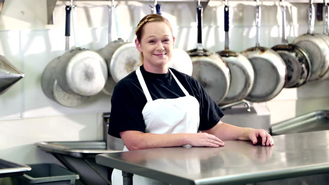 woman working in commercial kitchen - apron stock videos & royalty-free footage