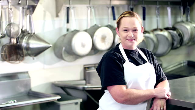 woman working in commercial kitchen - caterer stock videos and b-roll footage