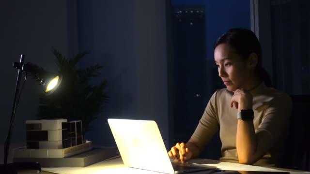 woman working in dark office - employee stock videos & royalty-free footage