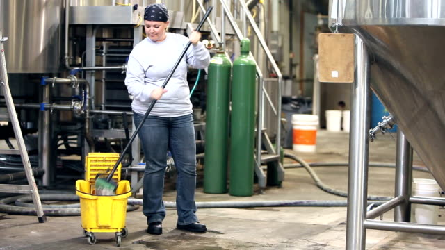 woman working in factory, mopping floor - caretaker stock videos & royalty-free footage