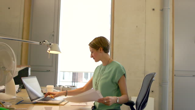 woman working in modern office - office chair stock videos & royalty-free footage