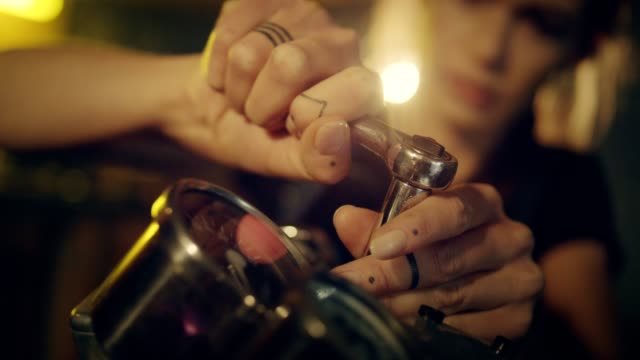 woman working in motorcycle workshop. close up on hands - mechanic stock videos & royalty-free footage