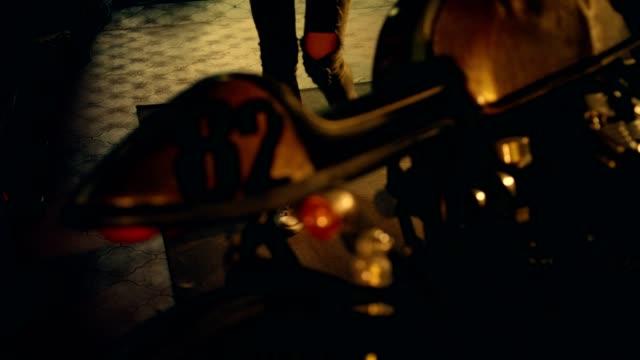 woman working in motorcycle workshop. details - motocross stock videos & royalty-free footage