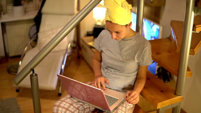 Woman working in pajamas on her laptop
