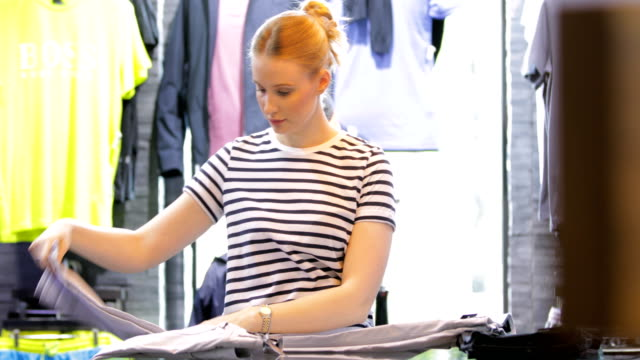 woman working in retail - fashionable stock videos & royalty-free footage
