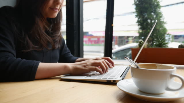 woman working laptop in cafe - coffee shop stock videos & royalty-free footage