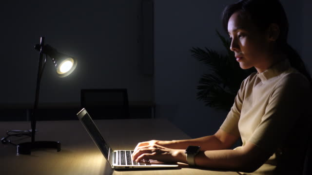 woman working late at night - lamp shade stock videos and b-roll footage