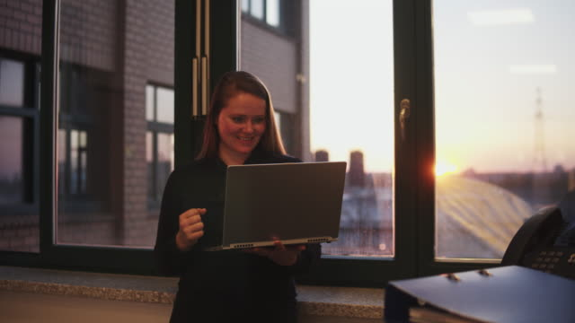 Woman working late in office.
