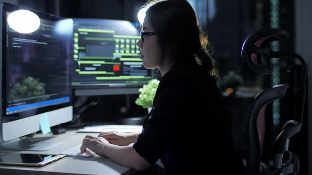 woman working late night with coding programer - large stock videos & royalty-free footage