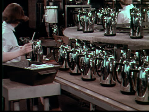stockvideo's en b-roll-footage met 1955 ms woman working on coffee pot production line / usa - 1955