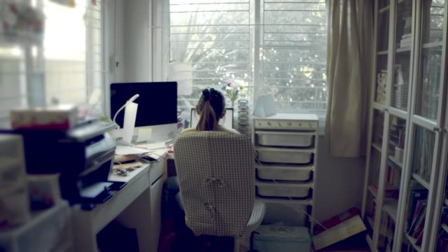 woman working on laptop - copy space stock videos & royalty-free footage