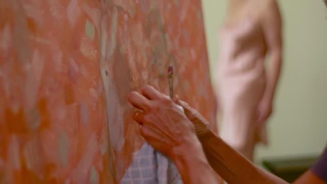 MS PAN TU  Woman working on large painting of model / Tivoli, New York, United States