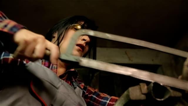 woman working on metal profile - work tool stock videos & royalty-free footage