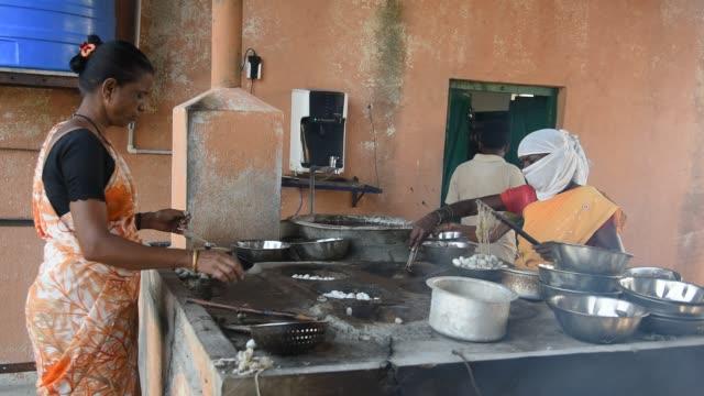woman working on silk making machine from cocoon of silkworm - filo articolo di merceria video stock e b–roll