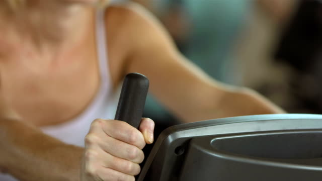 Woman Working On The Exercise Bike