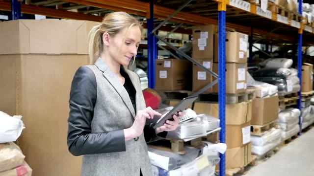 Woman working on-line in the warehouse