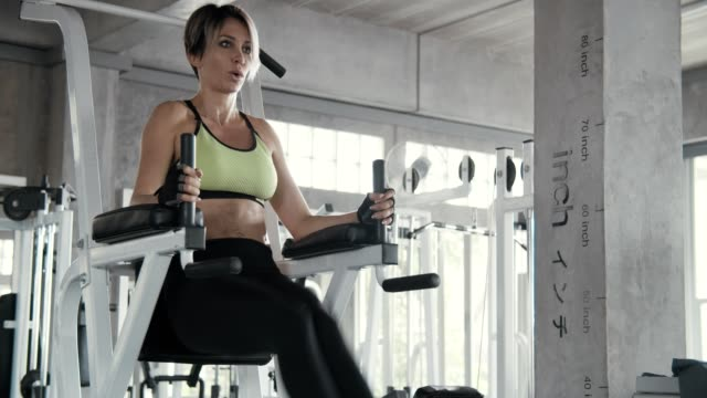 woman working out in the gym - only mid adult women stock videos and b-roll footage