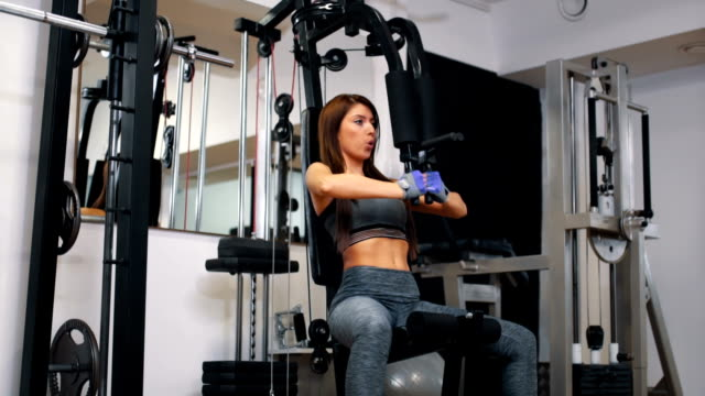 woman working out in the gym - lateral pull down weights stock videos & royalty-free footage