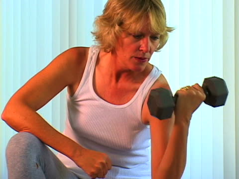 woman working out - arm curl stock videos & royalty-free footage