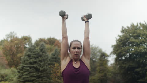 woman working out with weights in backyard - mid adult women stock videos & royalty-free footage
