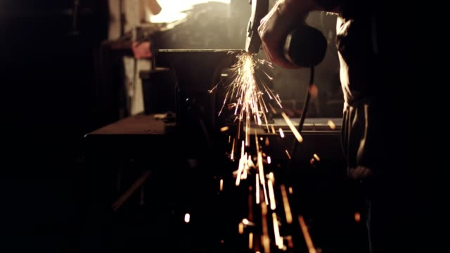 woman working with angle grinder - craftsperson stock videos & royalty-free footage