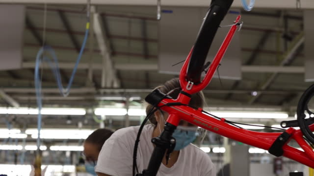 woman working with bicycle frame at production line in rte factory, in vila nova de gaia, porto, portugal, on monday, october 19, 2020. rte is the... - bicycle frame stock videos & royalty-free footage