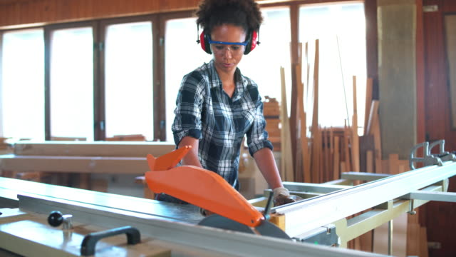 woman working with circular saw - carpenter stock videos & royalty-free footage