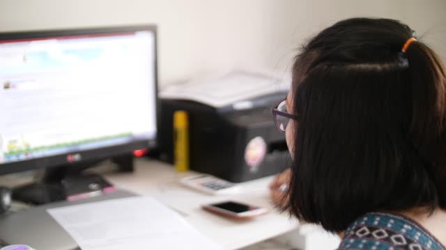 Woman working with computer desktop