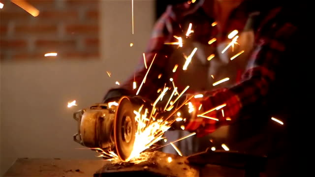 woman working with grinder,tilt up - metalwork stock videos & royalty-free footage