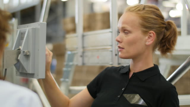 Woman working with her boss on the logistics production line