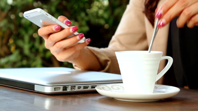 woman working with her phone on cafe - coffee drink stock videos & royalty-free footage