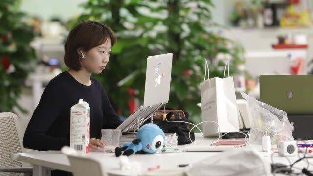 woman working with laptop in ant group headquarters in hangzhou, zhejiang, china on monday, september 28, 2020. - using laptop stock videos & royalty-free footage
