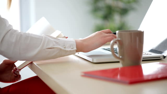 woman working with laptop - hot desking stock videos & royalty-free footage