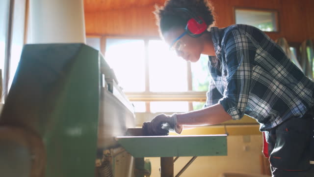 woman working with wood - safety glasses stock videos & royalty-free footage