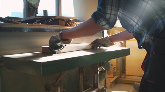 woman working with wood - sander stock videos & royalty-free footage