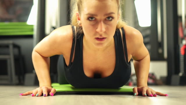 woman workout in gym - human muscle stock videos & royalty-free footage
