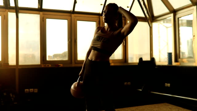 woman workout with kettlebell in gym - exercise machine stock videos & royalty-free footage