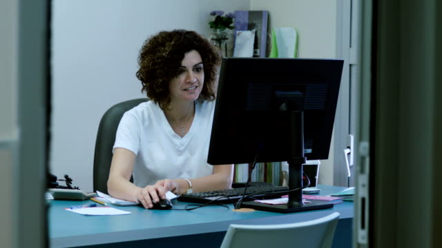 Woman works at the computer