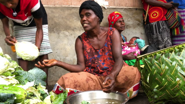 a woman works in a local produce market on december 6 2019 in tanna vanuatu 25 percent of vanuatu's 276000 citizens lost their homes in 2015 when... - south pacific ocean stock videos & royalty-free footage