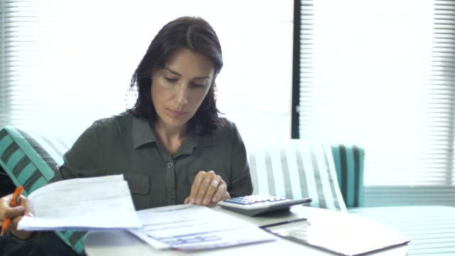 woman worried for taxes home banking and family budget - filing documents stock videos & royalty-free footage