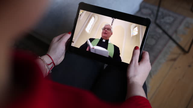 woman worshipping online during pandemic - priest stock videos & royalty-free footage