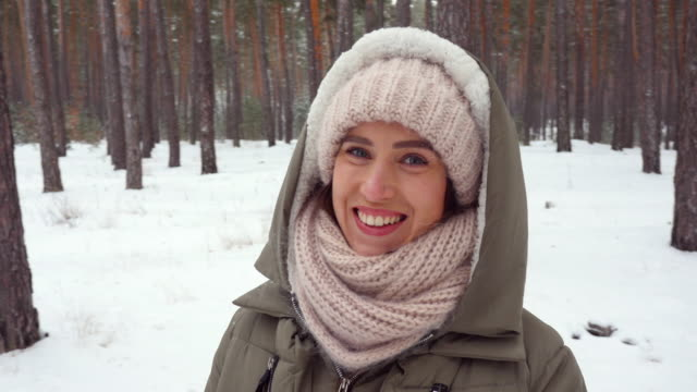 woman wrapped in a winter scarf posing at the camera on a wintry day - mitten stock videos and b-roll footage
