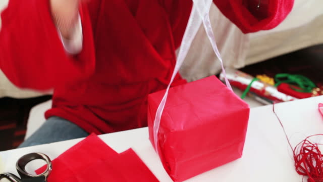 woman wrapping a christmas gift - christmas wrapping paper stock videos & royalty-free footage