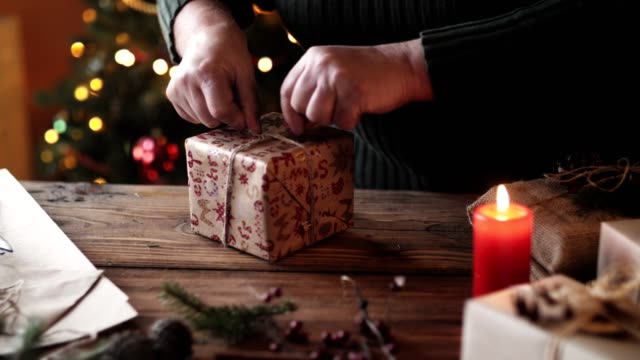 woman wrapping christmas gift. - christmas wrapping paper stock videos & royalty-free footage