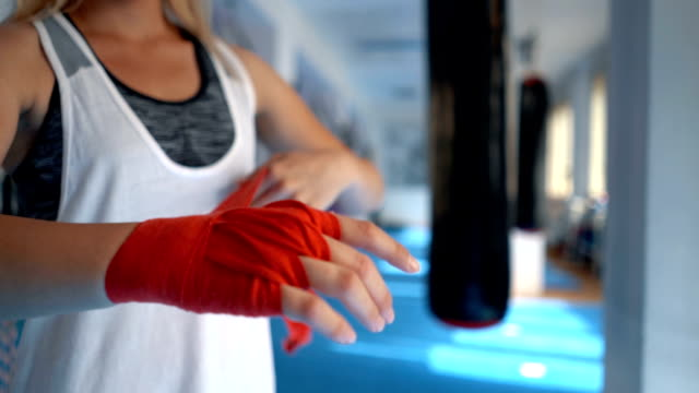 woman wrapping hands with boxing wraps - boxing glove stock videos & royalty-free footage